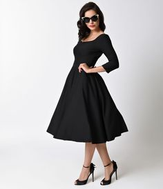 Readily radiant! A chic black 1950s vintage inspired dress from Glamour Bunny complete in a lightweight stretch cotton swing silhouette, Serena is to-die for! A darted and notched boat neck bodice boasts flattering three-quarter sleeves and a seamed natur