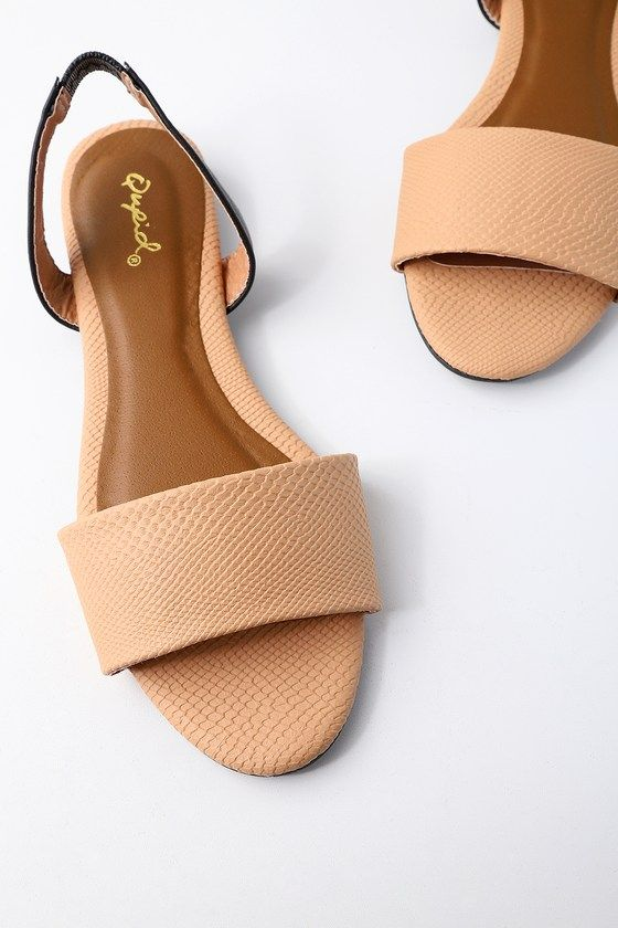 Step out onto the deck and enjoy the view in the Madora Toffee Beige Snake Print Slingback Flat Sandals! These chic, beige snake print sandals, are formed from textured vegan leather as it shapes a wide toe strap, and black slingback with elastic for fit.