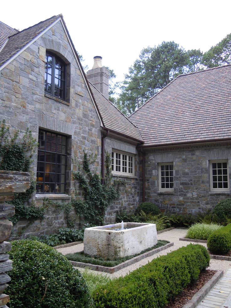 TROUGH FOUNTAINS Greystone Cottage courtyard by Howard Design Studio.: