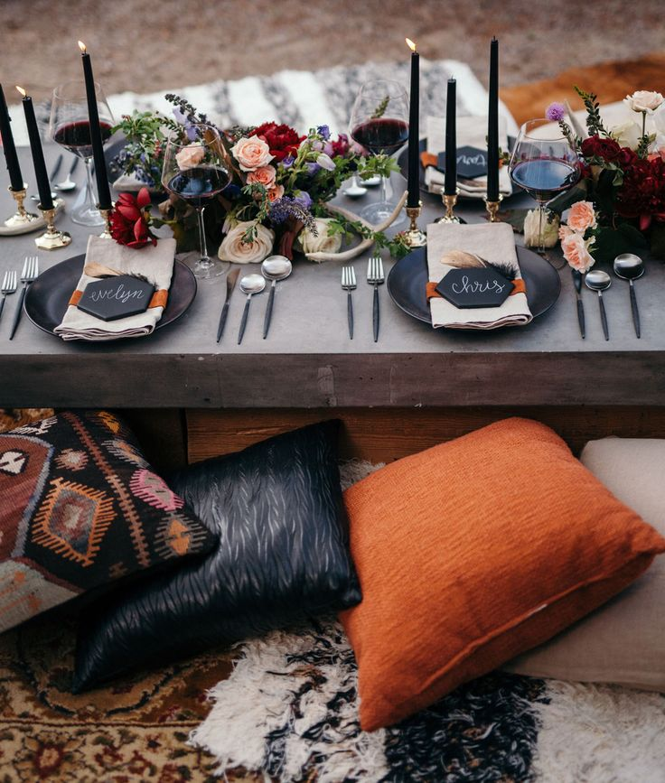 Dark Bohemian Summer Solstice tablescape with chalkboard tile place cards, leather, feathers, and black candles!