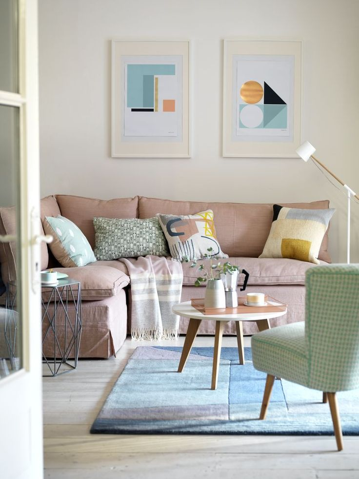 Use a soft neutral shade as background colour in a living room and add accents of pale blue, pink and mint green for a gorgeous pastel living room scheme. For more living room ideas visit housebeautiful.co.uk