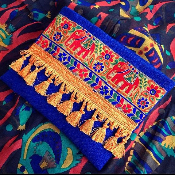Elephant Clutch, Clutch Purse, Bohemian Clutch, Boho Bag, Indian Style, Saks Blue Jute Handbag, Gift for her, Womens Bag This Elephant Clutch is perfectly handmade with high quality saks blue burlap, an ethnic embroidery and tassel trim. Elephant Clutch is really stylish and it is sure to catch everyones attention! This ethnic clutch will bring elegance to your style. It will be chic with jeans or dresses and you may use this both day and night. FEATURES: - Fabric: Saks Blue Burlap…
