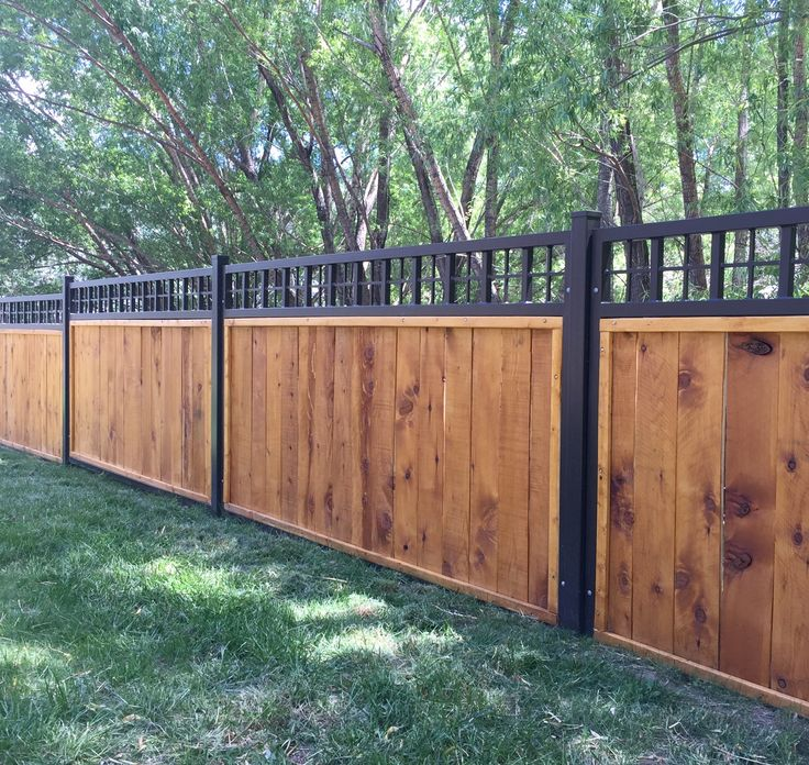 Steel frame fence panels with wood privacy