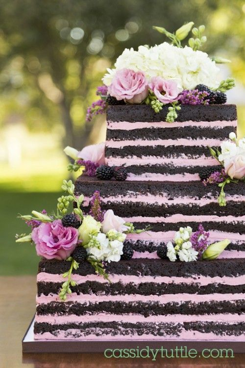naked chocolate cake with raspberry buttercream filling...except blackberry and a round cake!