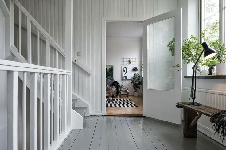 A beautiful converted carpenter's workshop I love these white, gray and black-painted wood floors.