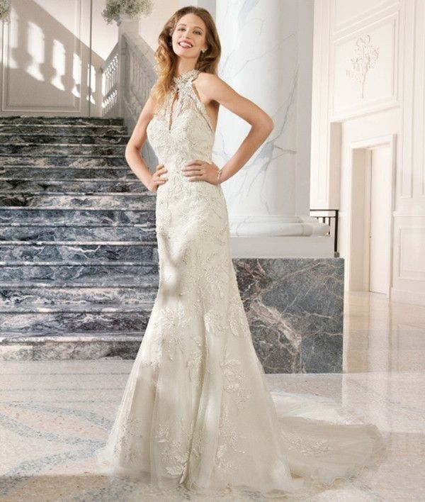 Lovely neckline on unique wedding dress | Demetrios Couture 2015 Bridal Collection via @WorldofBridal