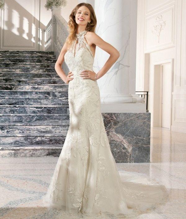 Lovely neckline on unique wedding dress | Demetrios Couture 2015 Bridal Collection via @WorldofBridal