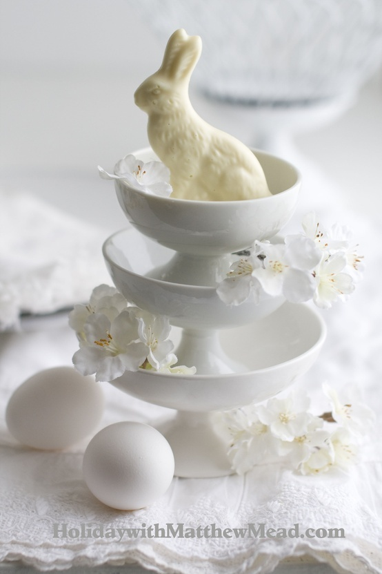 Mini compotes make a grand stand for a single white chocolate rabbit. Add flowers for a flourish.