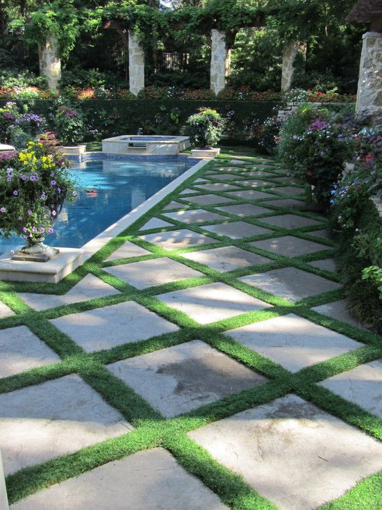 Lush - small mondo grass between pavers. I prefer the pavers to be square to the house rather than on the diagonal.