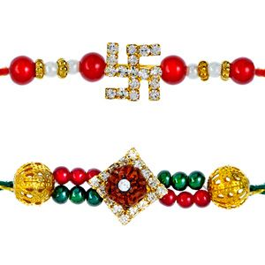 Ethnic and auspicious, the rakhi carry 'Swastic' in the center and studded with diamonds and beautiful red beads. It is paired with beautiful rakhi with 'Rudraksh' in the centre and is woven together with small colorful diamonds and beads. Rs 401/- http://www.tajonline.com/rakhi-gifts/product/rdr74/shubh-rakhi-set-of-2/?aff=pint2014/