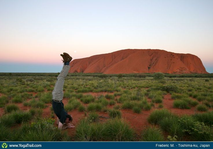 "#Yoga Poses Around the World: ""Forearm stand, in Uluru (Ayers Rock) in Central Australia by Frederic M."""