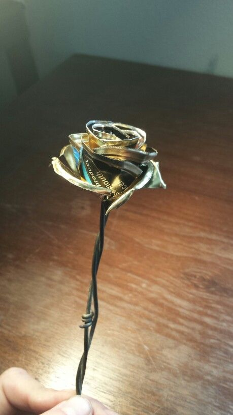 Barb wire and chewing tobacco can lid rose. Made by me. Proof of beauty,  one's trash can truly be another's treasure