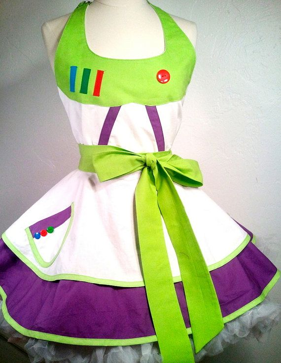 To Infinity and Beyond in our Buzz Lightyear inspired SassyFras Character apron! A customer challenged me to make a female version of Buzzs outfit for a trip to Disney with her family and this little number was born. This apron features a bodice that looks like Buzzs control panel, complete with a large red button and strips of colorful fabric coupled with a 2-tier circle skirt pinup design that is super girly, flirty, and fun! The colors of lime, purple and white echoes the look like Buzzs…