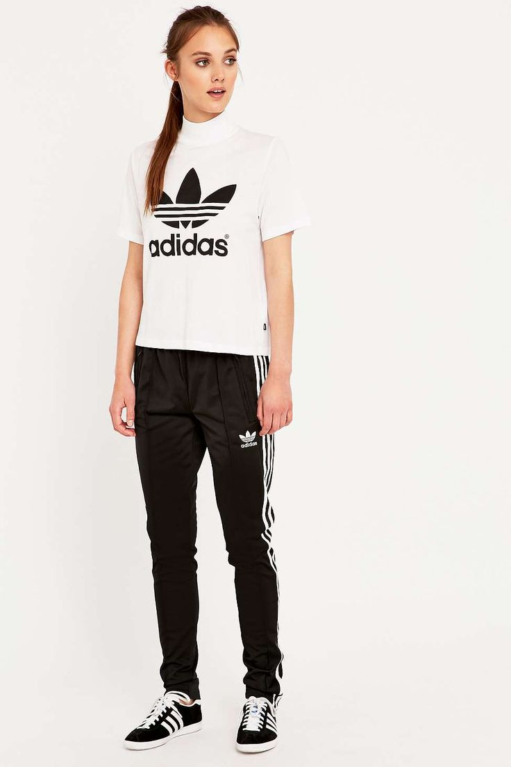 Shop adidas Berlin White High Neck T-shirt at Urban Outfitters today. We  carry all the latest styles, colours and brands for you to choose from  right here.