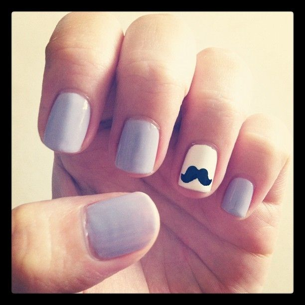 A quirky moustache: | 27 Ideas For Awesome Accent Nails