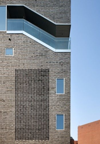 © Youngchae Park. brick screen wall. cut out staircase on corner of facade of brick building