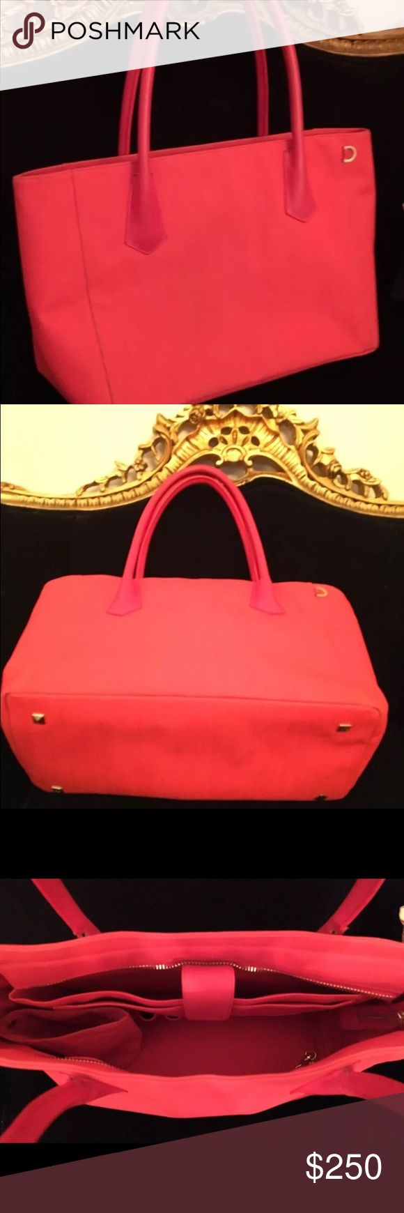 """Rare LTD Edition DAGNE Dover Vermillion 15"""" Tote RARE NO LONGER PRODUCED DAGNE DOVER 15"""" TOTE IN VERMILLION (red coral) Bells & whistles w padded compartment for 15"""" laptops/Tablets Pockets sized specifically for your wallet, Phone. 15"""" L x 7"""" W x 12"""" H   8.5""""  ALTHOUGH THE BAG IS NEW & HAS NEVER BEEN USED...THERE IS SOME CRACKING ALONG THE INNER PIPING OF HANDLES AND WHERE HANDLES MEET THE BAG.  I'M QUITE CERTAIN A SHOE REPAIR COULD EASILY FIX THE ISSUE.  UNLESS ONE LOOKED VERY CLOSELY THEY…"""