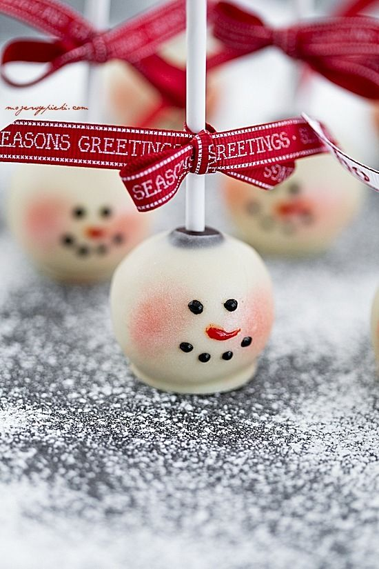 Cute snowman cake pop and like the idea of the ribbon added to it.