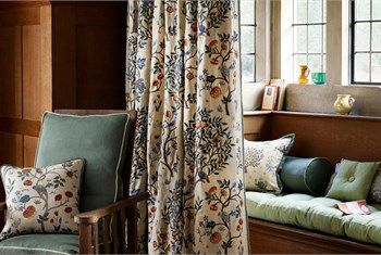 Curtains and cushion in 'Kelmscott Tree' Archive Embroideries, Morris & Co.