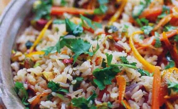 orange and pilaff rice with parsley sprinkled on top