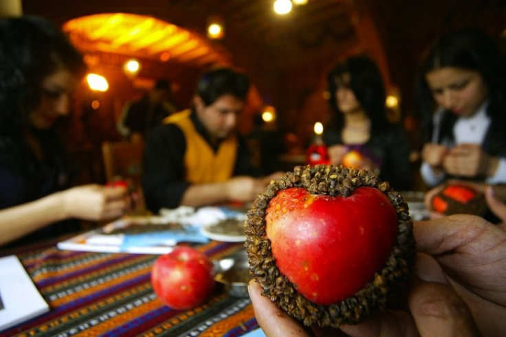 Iraqi Kurds decorate apples with cloves to offer to their partners on Valentine's Day at a restaurant in the Kurdish city of Arbil in northern Iraq on Valentines Day. The preservation of a red apple with cloves is a Kurdish tradition symbolizing Adam & Eve's relation with the apple, representing love & prosperity.   (Safin Hamed - AFP/Getty Images)