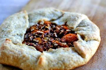 Rustic apricot tart, with cardamom and chipotle powder to give it its unique flavor.  Baked on the grill, perfect for a hot summer day when you don't want to heat up the kitchen.