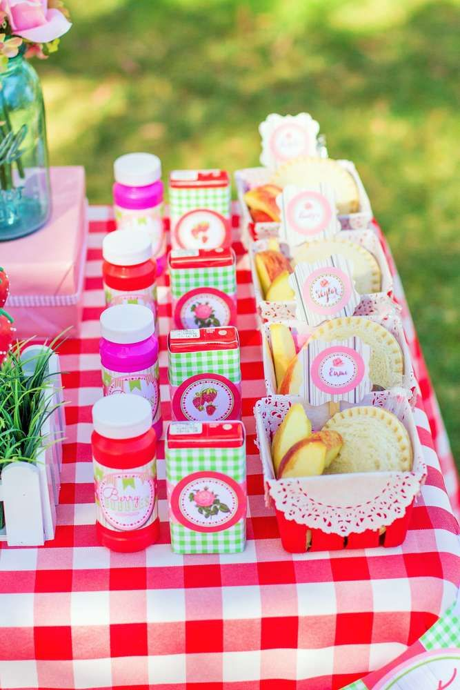 Favors and snacks at a strawberry picnic birthday party!  See more party planning ideas at CatchMyParty.com!