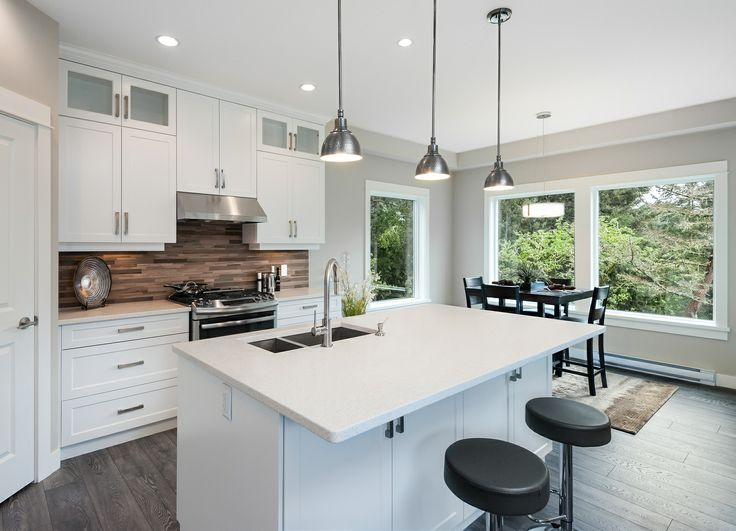 Recent real-estate shoot with The Limona Group for the 2014 CARE Awards. I love the clean lines of this kitchen. The glass tiled back-splash is lovely, and contrasts nicely with white custom cabinetry. I could EASILY get used to waking up in the morning and making coffee in this beautifully designed space...  www.nathanphilpsphotography.com
