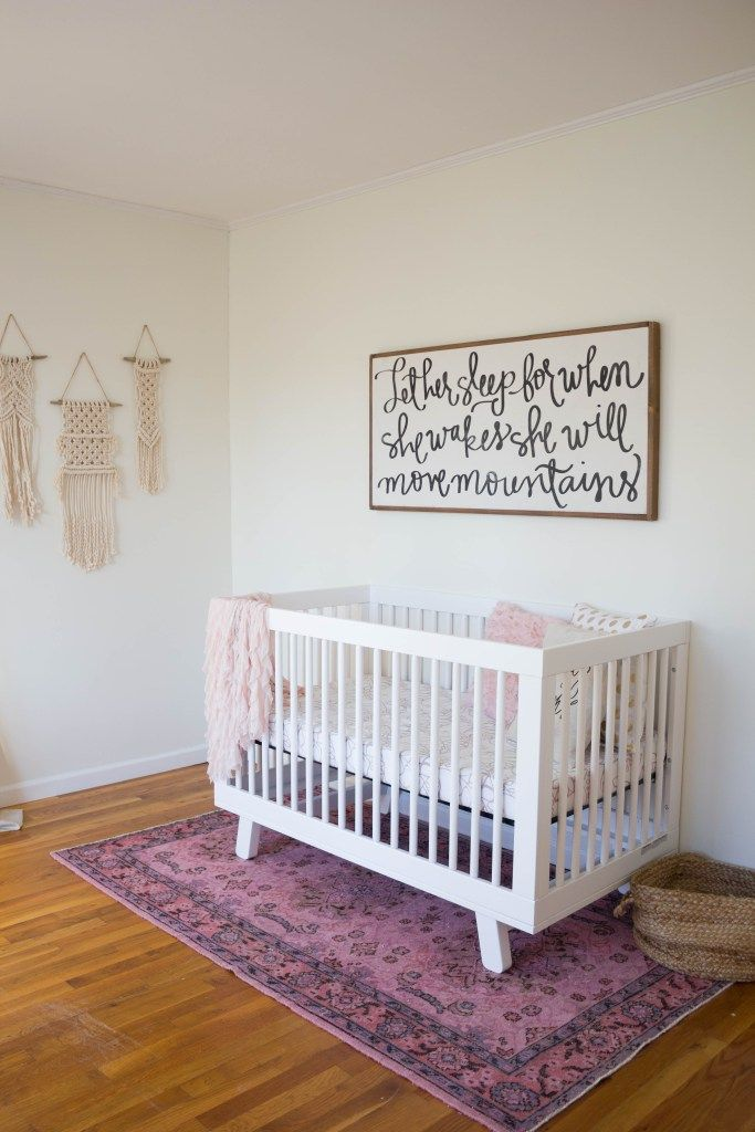 A gorgeous boho glam baby girl nursery, featuring the Babyletto Hudson Crib and Delta Children Avery Glider