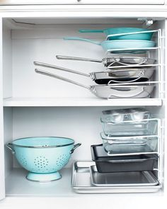 brilliant idea - turn wire organizer on its side to stack pans.  mind is blown