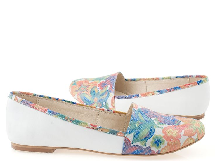 White espadrilles with floral decorations. Very soft and comfortable. Made of high quality leather.