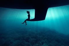 Just a girl sitting on the keel of a boat underwater - Imgur