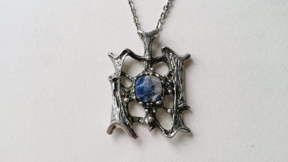 Tapani Vanhatalo (FI), modernist pewter pendant with a stained silver finish and set with a raw lapis lazuli stone, 1970s. #finland   finlandjewelry.com