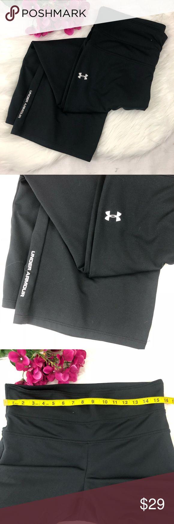 Under Armor Black Cropped High Waist Pants Stretchy black pants from Under Armor. They're cropped length with a higher banded waist for comfort and a slimming effect. Great for working out or just lounging around. They're in excellent condition with no flaws. The waist, rise, and inseam measurements are included in the last three images. (Location) {no trades - no modeling} Under Armour Pants Capris