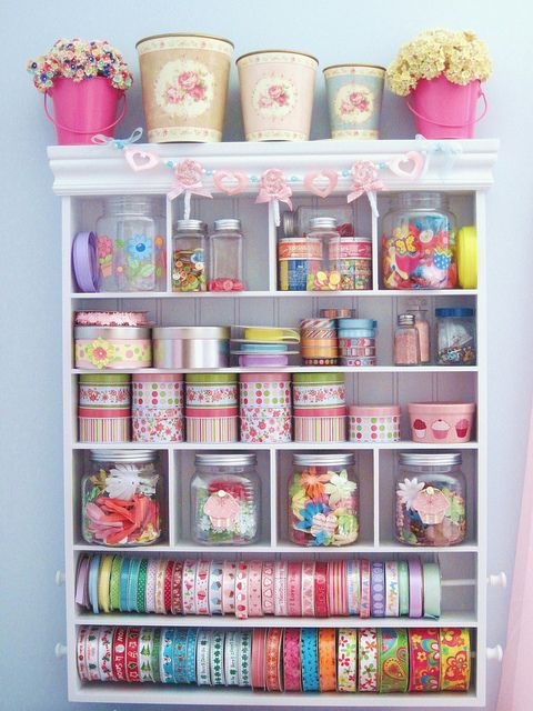 Craft room, but this could also look great in a girls' room. Use pretty jars and boxes to put crayons, hair pins and treasures. This is sooo cute!