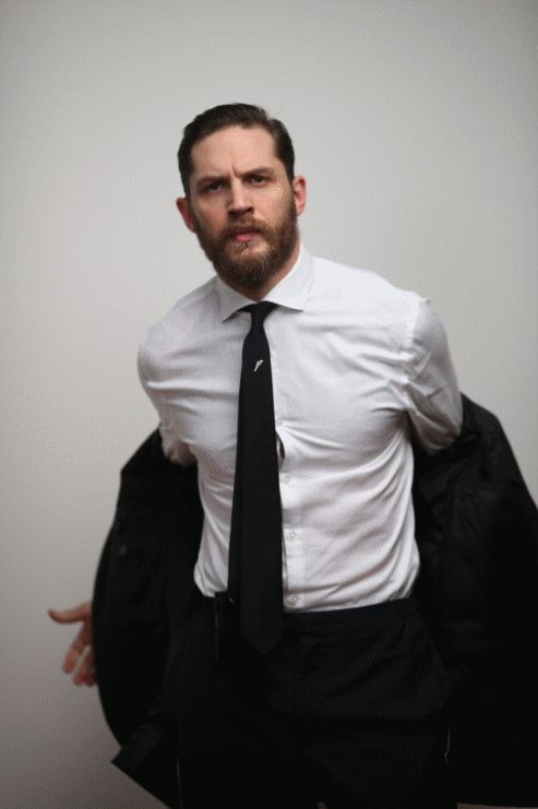Tom Hardy Esquire stripping gif ❤❤❤❤ All it needs is some sexy music. God, he's soooooo hot. #shirtless muscles suit