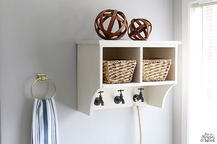 Featuring two deep cubbies and three hooks for hanging, this pretty storage shelf is perfect for your bathroom. Store hand towels, toilet paper, and other bath accessories in the cubbies or hide them away in wicker baskets. The faucet shaped hooks add a whimsical touch to the whole project. Get the free DIY plans from @jenwoodhouse at buildsomething.com