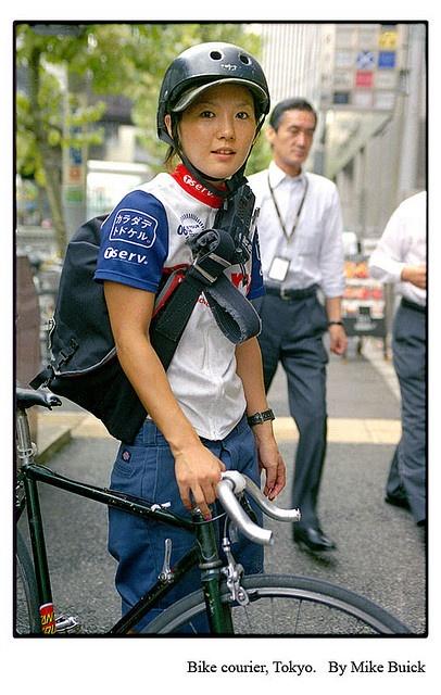"Bike courier, Tokyo, Japan ""Bicycle messenger girl"""