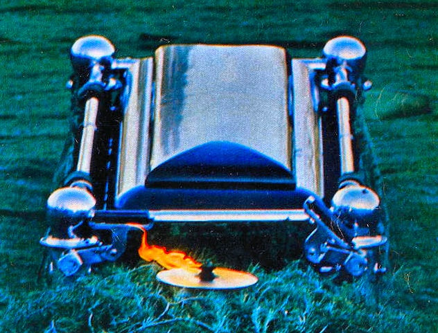 11/25/63 - The eternal flame flickers in front of JFK's casket at Arlington Cemetery.