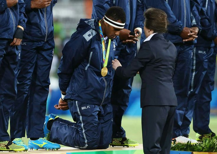 RIO DE JANEIRO, BRAZIL - AUGUST 11: HRH Princess Anne, Princess Royal presents the Fiji team with their gold medals during the medal ceremony for the Men's Rugby Sevens on Day 6 of the Rio 2016 Olympics at Deodoro Stadium on August 11, 2016 in Rio de Janeiro, Brazil. (Photo by David Rogers/Getty Image)