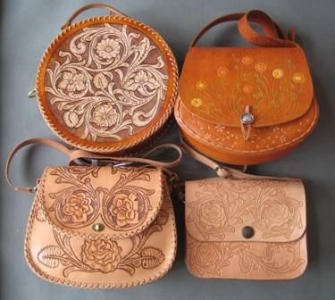 An assortment of tooled leather purses