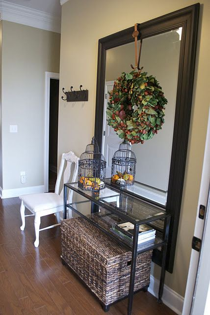 Love using oversized pieces to create drama and interest in a small space. Huge mirror in entry way.