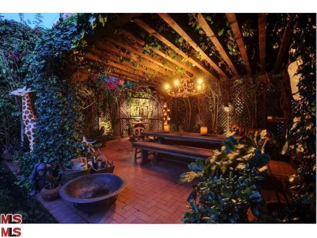 amazing covered garden dining area, love the chandelier.