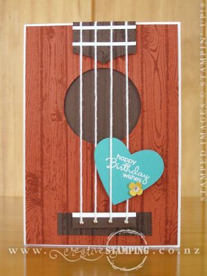 """My daughter's ukulele birthday card. The idea for this came from Ruth Hamilton's guitar card (http://apassionforcards.blogspot.co.uk/2013/01/some-more-of-my-cards-in-cardmaking-and.html), but I used Cajun Caze for the """"body"""" to match the mahogany-wood of the ukulele. The Hardwood stamp makes a lovely tone-on-tone wood grain. www.creativestamping.co.nz 
