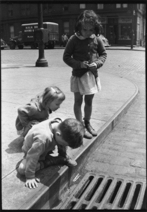 [Children Playing on Sidewalk Next to Gutter Grating, New York City] 1928–33  Walker Evans/ Film negative: 2¼ x 3¼ in. The Metropolitan Museum of Art, New York.