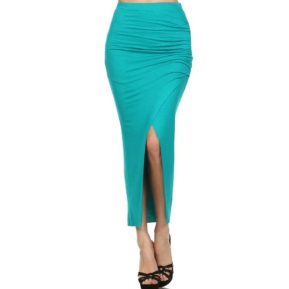 Teal Maxi Skirt Teal fitted maxi skirt. Ruched on the side and slit in the front. Elastic waist. Materials:  95% Rayon  5% Spandex Skirts Maxi