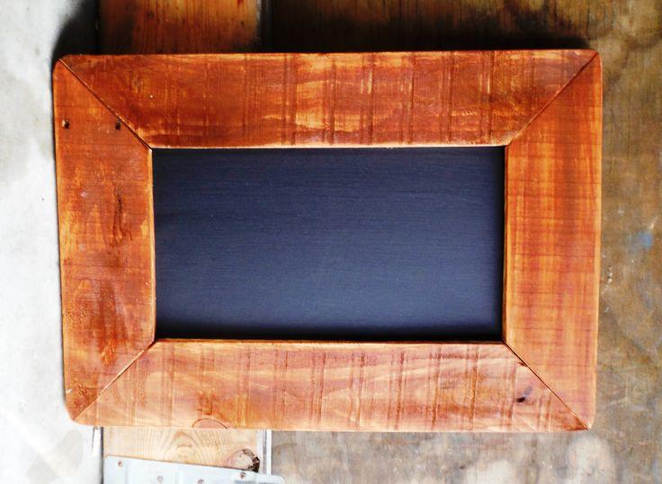 Picture framed black board.