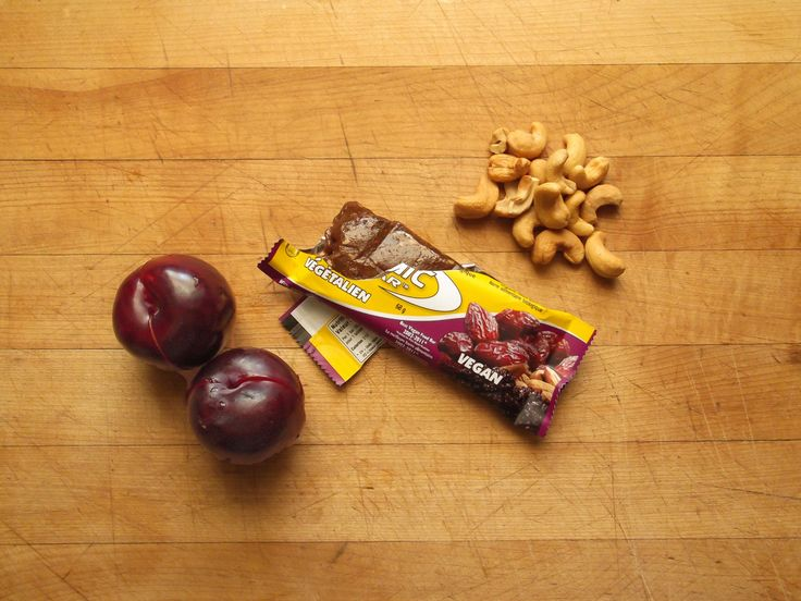 black plums, organic food bar, and roasted cashews