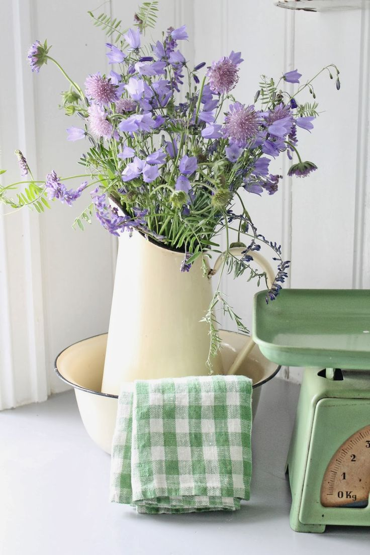 pale Scabiosa in simple ceramic pitcher (not with kitchenwear obv)