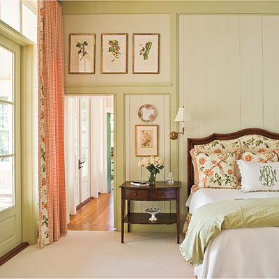 The soft greens, creams, and peaches make this room really charming.